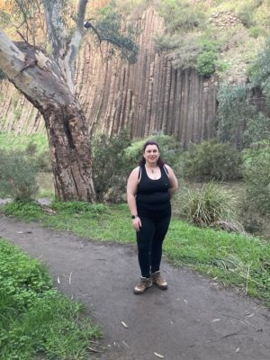 fiona in front of organ pipes smiling