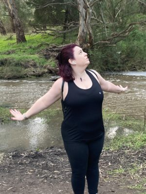 fiona in front of river arms outstretched
